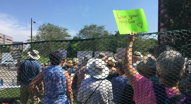 Seniors protest US treatment of migrant kids by 'caging' themselves in excessive heat